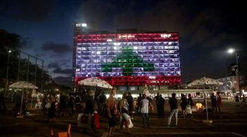 A building in Tel Aviv displays the Lebanese flag as a sign of solidarity after the port explosion that devastated Beirut.