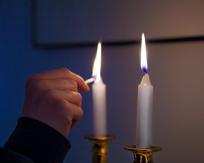 lighting shabbat candles - Photo by Robert Couse-Baker via Flickr